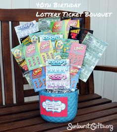 "Lottery Ticket Bouquet | 40th Birthday Gift: My boss Holley turned 40 this year so I wanted to put a positive spin to her new age. For her birthday gift, I made her a lottery ticket bouquet made of 40 $1 lottery tickets.  I added a gift tag that said, ""Some people say that turning 40 sucks. Here's 40 chances that this year brings you good luck!"""