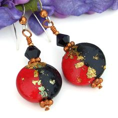 Bold and dramatic, these red, black and gold earrings will make a statement whenever worn. The MAGICAL MYSTERY TOUR handmade earrings were created with artisan made red and black polymer clay beads with added real gold leaf, sparkling jet black Swarovski crystals, copper and sterling silver earwires. Just imagine these unique dangle earrings on your own ears, worn with a white shirt and black jeans or with your little black dress! Beautiful! The MAGICAL MYSTERY TOUR beaded earrings were…