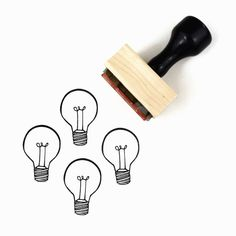 Rubber Stamp w/Wood Mount & Handle  ▴ DESIGN ▴ Bright Ideas Lightbulb  ▴ SIZE ▴ Design is 1 x 1.5 (2.5 cm x 3.5 cm)  ▴ DETAILS ▴ ▴ This stamp is a hand-drawn design. ▴ Having an A-HA moment? Introducing the Bright Ideas Lightbulb rubber stamp. ▴ Looks great upside-down with a simple line for that light in the attic look, too. ▴ Easy sizing for gift tags: works great on 2.75 x 1.375 manila tags (as shown) & small muslin bags.  ---------------  For more Spring + Summer Designs: htt...