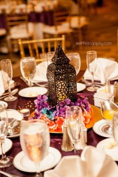Beautiful Arabian or Moroccan tablescape for a wedding in Orlando, FL! Decor by Kristy Rapp, and centerpieces courtesy of the bride's family. To read more about this unique Orlando wedding, or to hire a belly dancer for your event, check out http://www.CarraraNour.com  Photo: Nelson Rodriguez
