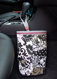 DIY Car trash can bag, hang on the center gear shift- add loops with buttons to hold down plastic bag handles on the sides