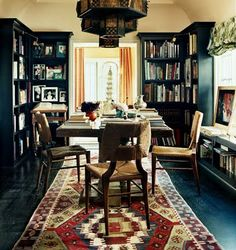 Dark walls, yellow orange drapes, oriental rug, natural seat cushions...