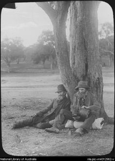 Two Swagmen resting beneath a tree during their travels of Australia. Photo taken by John William Photo shared by the National Library of Australia, [transparency] . Old Pictures, Old Photos, Vintage Photographs, Vintage Photos, Australian Photography, Australia Day, Historical Pictures, Look At You, Cool Eyes