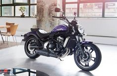 Cleanest garage ever.. Oh and a purple 2015 Vulcan S Kawasaki Muscle Cruiser
