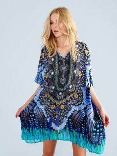 Parides dress, This unique printed silk dress is ideal for hot Summer days, and is accented with delicate touches such as beaded tassels and crystals. Parides luxury dresses are high end and made of the highest quality viscose silk, #paridesdress