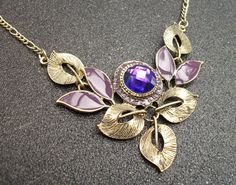Antiqued Gold Leaf and Purple Faceted Stone by Kikiburravictoriana, $15.00