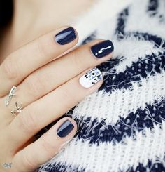 LOVE these nails! The blue and the white nail! #WinterNails #NailArt