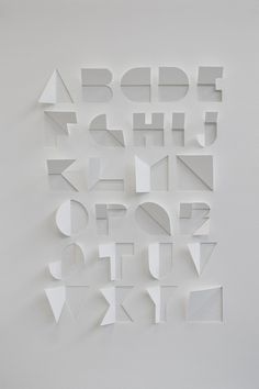 A typeface created from a single sheet of paper, with only cuts and folds. The process used to create the alphabet involved looking at origami and symmetry within letterforms. Type Design, Design Art, Web Design, Logo Design, Interior Design, Typography Letters, Graphic Design Typography, Hand Lettering, Cursive Calligraphy