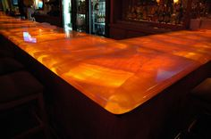 Onyx contertops w/ lighting below- Brian and I saw this in a house being built, sooo beautiful !!