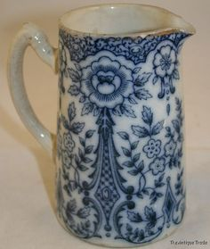 Blue and white vintage.  I WANT to collect blue and white pitchers, but I'm completely and totally OUT OF ROOM! mr