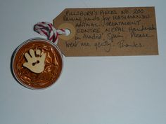 Pillsbury's Pieces No, 200. Pin with caramel metallic capsule with wooden hand button decorated with glass bead as ring.. In exchange for a donation to KATHMANDU ANIMAL TREATMENT CENTRE, Nepal. Available at St. George's Church, Madrid on Saturday 13 June from 11.00 - 15.00.