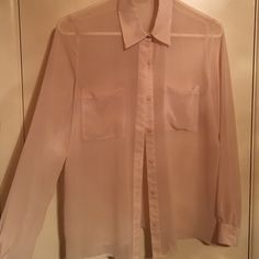 Delicate, blush colored blouse This sheer fabric is light weight and can be dressed up, or down. The light, blush color is very neutral and looks great with a bright necklace or shoe! Tops Blouses