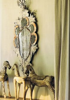 Mirror and Carved Wood Horses