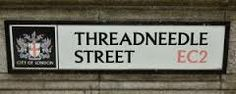 Threadneedle Street, EC2, London. The name derives from the coat of arms of the Needle makers' Company that once stood on this street. However, during the Middle Ages, it was a red- light district and was so named 'Gropecuntlane'.