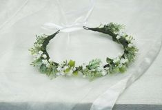 This simple and elegant greenery crown is made of artificial greenery / foliage finished with white satin ribbon to tie back Easy to adjust to a preferred size Made to fit adults but can also can fit children ( please check measurements) wire base length - 19 inch ♥ Take a peek at other floral Flower Girl Crown, Flower Crowns, Floral Crown, Flowers In Hair, Dried Flowers, Purple Flowers, Leaf Crown, Child Please, Different Flowers