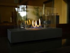 """""""Incendio"""" is a sleek new tabletop/desktop ethanol burning personal fireplace. Chic enough for any executive desk or formal tablescape, Incendio is the perfect option to candles, it's soft and romantic. The colorful flames are accentuated against classic black and behind the tempered glass windscreen... beautiful and functional. Easily adjust the flame height or extinguish it completely with the provided dampener tool."""