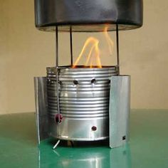 30 Awesome DIY Projects that You've Never Heard of / Wood-Burning Camp Stove - All you need is a large tin can, a few metal tent pegs/stakes, and a drill to make this camp stove.