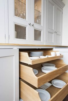 Clever storage solutions. See more at http://woodworkkitchens.co.uk/kitchens/kitchen-details/