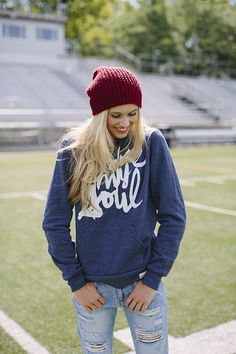 Football game outfit inspiration featuring hoodie, jeans and beanie.