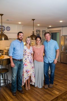 Chip and Joanna pose for a group shot with homeowners Jamie and Kyle Ferguson in the newly renovated kitchen.