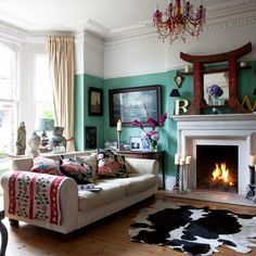 colour wall, rug, fire. cozy.