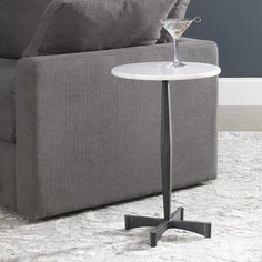 The perfect landing spot for a drink or book, this accent table features a solid steel base finished in aged iron accented by an elegant white marble top. True to the nature of natural materials, each piece will have unique marbling and veining throughout. Marble Top, White Marble, Accent Furniture, Living Room Furniture, White Accent Table, Uttermost Mirrors, Drink Table, Sit Back And Relax, End Tables