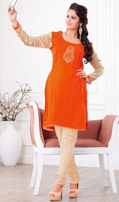 Ameliorate your charm draping this orange georgette and jacquard kurti. Beautified with patch work all synchronized nicely through the trend and style and design of tunic. #BeautifulOrangeShadesOfTunic