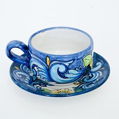 Coffee cup & saucer with sunflowers on a white background with a blue border. Click on the image to learn more about this beautiful coffee cup.