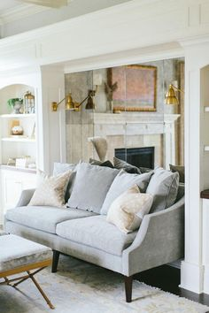 Mirror the wall behind your couch to make a room look bigger.   25 Absoluely Gorgeous Living Room Decor Ideas   StyleCaster
