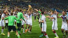 Thomas Mueller of Germany celebrates with the World Cup trophy