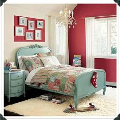 Turquoise and red is my favorite color combination, and I covet this bedroom and the desk area with the red desk and grouping of antiqued mirrors over it.