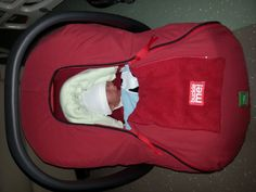 This bouncing baby boy is ready to go home...he is kept safe and warm with a baby parka for the infant car seat.