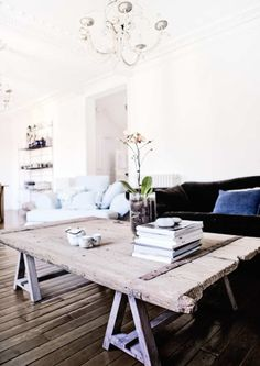 Living Room Concept: French Navajo Modern Industrial {rustic coffee table, velvet sofa, white walls}