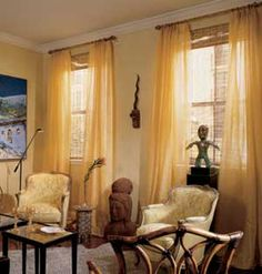 Nevermind the colour/style ,but a good decorating concept: Ideas for Multiple Windows -- When space between windows is too narrow to use but too wide to simply cover up, curtains or drapes in a shade close to the color of the wall can both divide and blend the windows. The long, gold sheers on these windows accent the room's height while blending into the wall color.