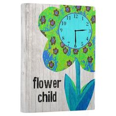 "Weathered wood wall clock with a floral motif and typographic details.   Product: Wall clockConstruction Material: WoodColor: MultiFeatures: Ready to hangAccommodates: Batteries - not includedDimensions: 20"" H x 14"" WNote: All hanging hardware includedCleaning and Care: Wipe with a damp cloth"