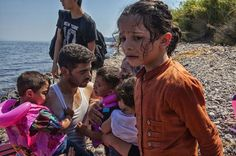 Those who cannot swim find the journey traumatic. Children may need comforting. Tamara, from Syria, has salt water on her hair, face and clothes, but it will dry rapidly in the scorching heat