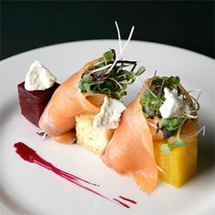 House Cured Citrus Salmon with Red and Yellow Beet Salad, Coach Farms Goat Cheese and Pickled Beet Reduction.