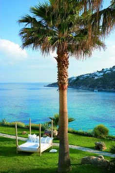 Unwind in lavish setting hovering over the famous Psarou Beach )
