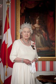 Queen Elizabeth II poses with a painted portrait of her great-great-grandmother Queen Victoria, who celebrated her own Diamond Jubilee as Queen in 1897. Rideau Hall. Ottawa, Ontario. July 1, 2010. [Department of Canadian Heritage]