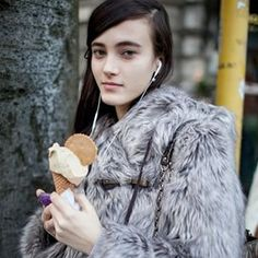 When in Milan, you must try the gelato, even if you're wearing a fur coat. Street style spotted by Kuba Dabrowski.