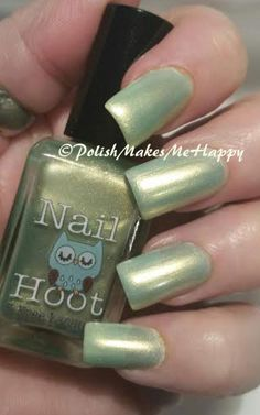 "Spring green, with a hint of gold shimmer... THAT is my kind of nail polish! From Nail Hoot Indie Lacquers ""Exodus"" is the green that I love! My pictures show three coats over a thin white base... the pearly look is really the perfect touch!! For some reason, my pictures are a little washed out... hmmm"