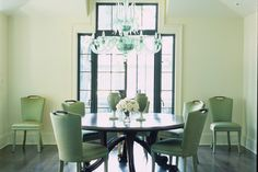 Stunning dining room with a glass #chandelier, by Jorge Rosso Architecture Interiors. Discovered on www.Porch.com #interiors #design #interiordesign #decor
