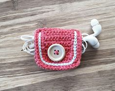 Coral Crochet Cord Holder, Headphone Organizer, Earbud Organizer, Smartphone Accessory, Earphone Cord keeper, Headphone USB Winder by LittleKnittedThing on Etsy https://www.etsy.com/listing/232317687/coral-crochet-cord-holder-headphone