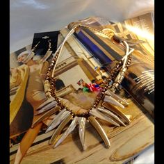 """Brown and Ivory Necklace set This beaded layering set with two gold tone decorative bead stations and brown and go,d pointed bars. Approximately 18"""" in length and matching earrings. (This closet does let trade or use PayPal. ) Jewelry Necklaces"""