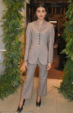 Model behaviour: Neelam Gill looked stunning in a cropped checked suit...