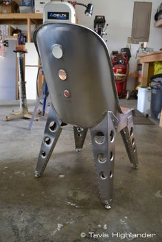 Aluminum sheet metal, buck riveted, aviation inspired chair (rear view) industrial style furniture
