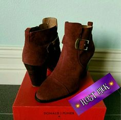 Gorgeous Booties by Donald J. Pliner NWT These gorgeous ruby Booties by Donald J. Pliner feature a brass colored buckle accent on the side. Throw these on with a dress or some skinny jeans & you're ready! They are actually more of a wine color. They run true to size. Brand new. Donald J. Pliner Shoes Ankle Boots & Booties