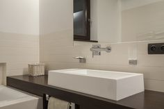 Large White Sink With Wall Mounted Faucet And Matching Soap Holder