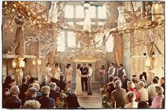 Barns or other venues with vaulted ceilings are a romantic choice for a winter ceremony. This space is particularly divine with its simple design and wintry vibe.Related: 50 Gorgeous Wedding Ceremony Structures