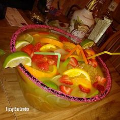 The Tropical Fishbowl Margarita! Perfect for your Friday night! For the recipe, visit us here: www.TipsyBartender.com